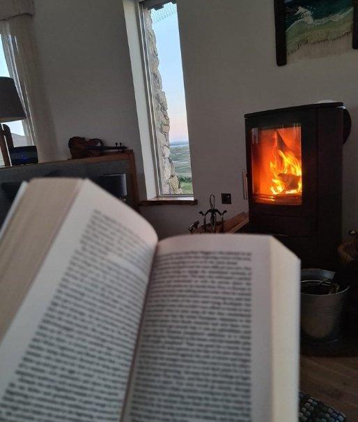 hygge on harris reading by fire